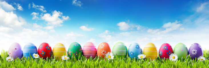 Easter Banner - Colorful Painted Eggs In Row On Grass