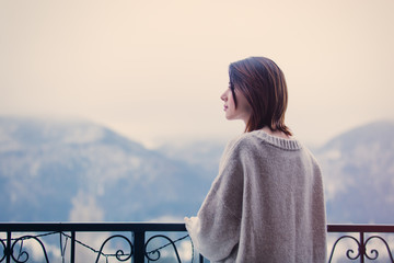 Portrait of a young redhead woman with mountains on background Wall mural