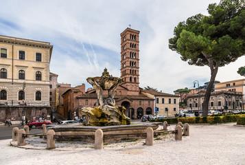 Rome, Italy. Tritons Fountain (1717) and the Basilica of Santa Maria in Cosmedin (VI cent.) on the area of Bocca della Verita