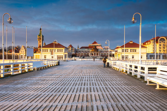 Cold morning, Pier in Sopot at sunrise with amazing colorful sky. Winter in Poland.