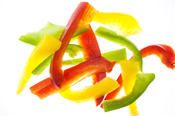 Sliced Green, Red & Yellow Pepper on white background