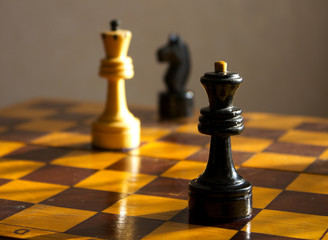 black queen and white king on the chessboard