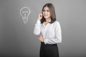 Beautiful business woman with idea icon