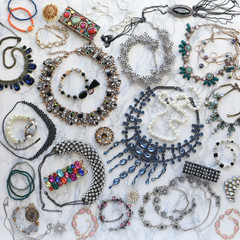 Colorful fashion jewellery on marble background