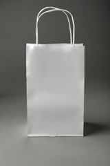 Blank paper bag on grey background
