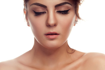 Woman with closed eyes and professional make up