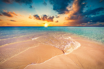 Tropical beach with white sand and clear turquoise ocean. Maldiv