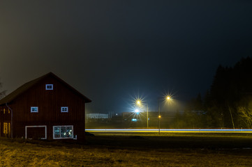 A long exposure with a barn at night