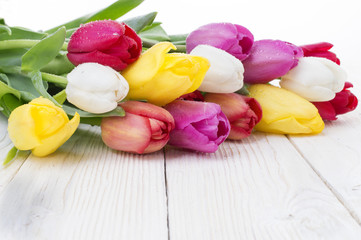 bouquet of tulips on rustic wooden board, easter decoration