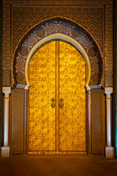 Golden door of the Royal Palace (Dar el Makhzen) in Fez at night, Morocco