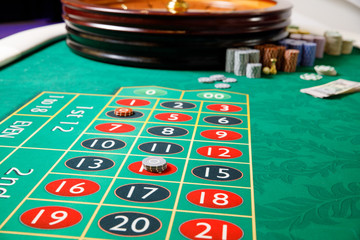 casino roulette tokens green table