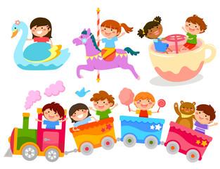 happy kids having fun on amusement park rides