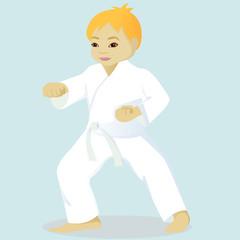Little boy is engaged in karate