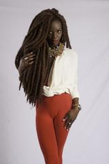 Black woman with dread locks pondering