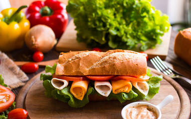 Delicious and Tasty sandwiches with turkey, ham, cheese, tomatoe