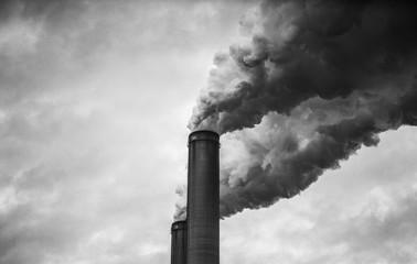 Black and White of smoking smokestacks