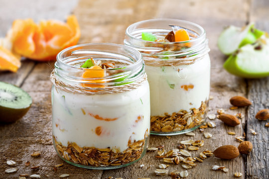 Delicious healthy American breakfast made of granola, yogurt and fruits. Classic US morning meal. Traditional healthy snack. Close-up shot.