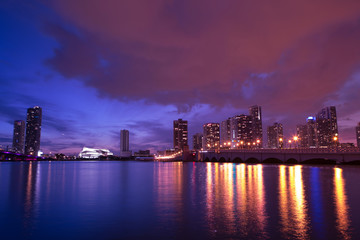 View on Miami Downtown Knight Concert Hall and MacArthur Causeway at night time with a view on a bay, USA