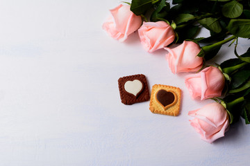 St. Valentine's Day background with five pink roses and cookies