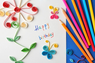 Handmade gift card and colorful crayons, close up
