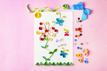 Handmade gift card and colorful buttons on violet background
