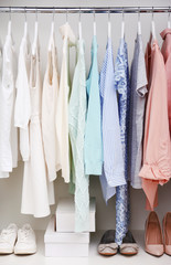 Collection of clothes hanging on a rack