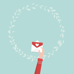Hand holding love letter for valentine's day