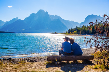 Grand Teton National Park, Wyoming.  Couple watching the sunset.