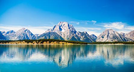 Fototapeta Grand Teton National Park, Wyoming.  Reflection of mountains on Jackson Lake near Yellowstone. obraz