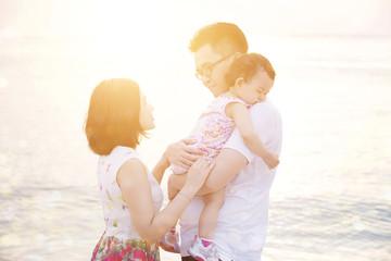 Family enjoying summer vacation at seaside