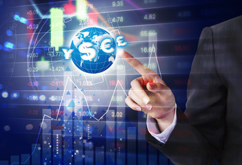 Double exposure of business woman hand touching world with currency symbol and stock market design