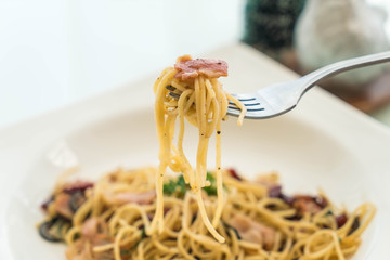 stir-fried spaghetti with bacon and garlic