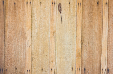 grungy brown wood plank wall with nails at the corner