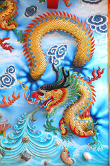 Chinese dragon sculptures on the temple walls Sian Pattaya in Thailand.