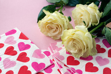 roses and napkins with red hearts