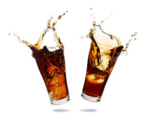 Couple cola splashing out of a glass., Isolated white background.
