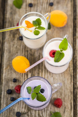 Milkshakes with raspberries, blueberries, apricots and mint lea