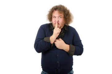Secret. Funny guy says shh. Hush. Man requires silence.