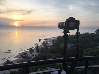 camera take sunrise picture over sea and beach at Hua Hin, Thailand