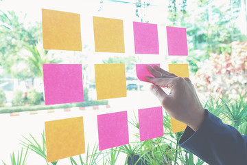 Note paper reminder schedule board. Business people meeting and use post it notes to share idea. Discussing - business, teamwork, brainstorming concept