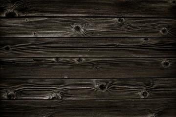 Schwarzer rustikaler Holzhintergrund