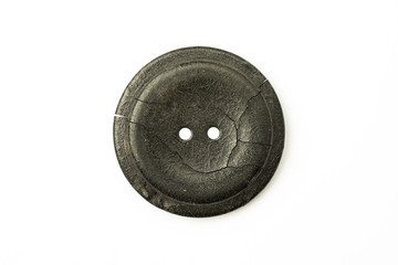 The old Round button with cracks on white