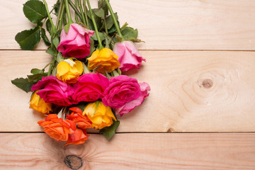 Bunch of roses on wooden background