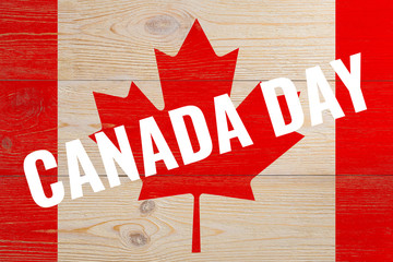 canada day on painted flag wooden background