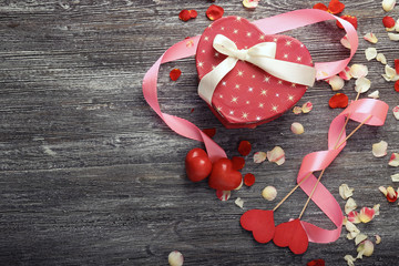 St. Valentines Day concept. Gift box and decorations on wooden table