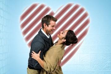 Composite image of happy romantic couple hugging