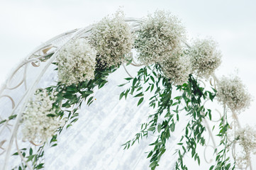 Wedding decoration of white flowers. Arch for registration