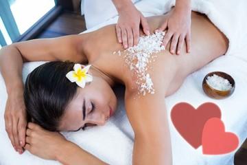 Composite image of salt scrub massage with love hearts