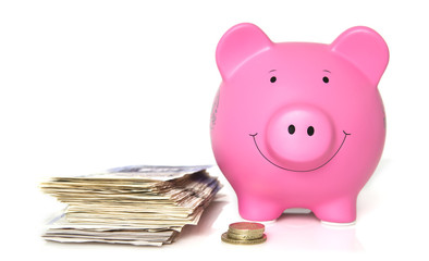 Pink Piggy Bank with a pile of banknotes and coins