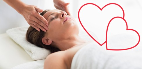 Composite image of forehead massage woman love hearts
